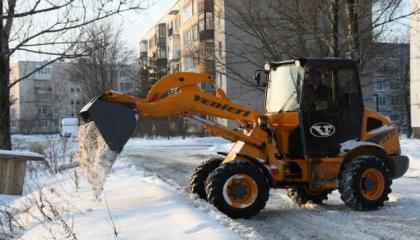 Фронтальный погрузчик VF 2.63 на уборке снега